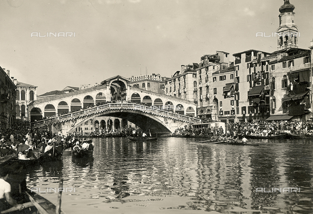 View of the Rialto Bridge in Venice during a regata