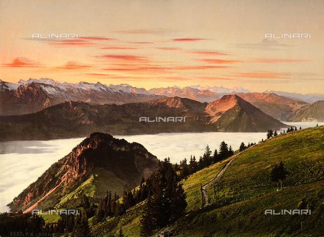 "The Swiss mountain range and the ""sea of fog"", as viewed by the panoramic sight of Rigi-Scheidegg, Switzerland."