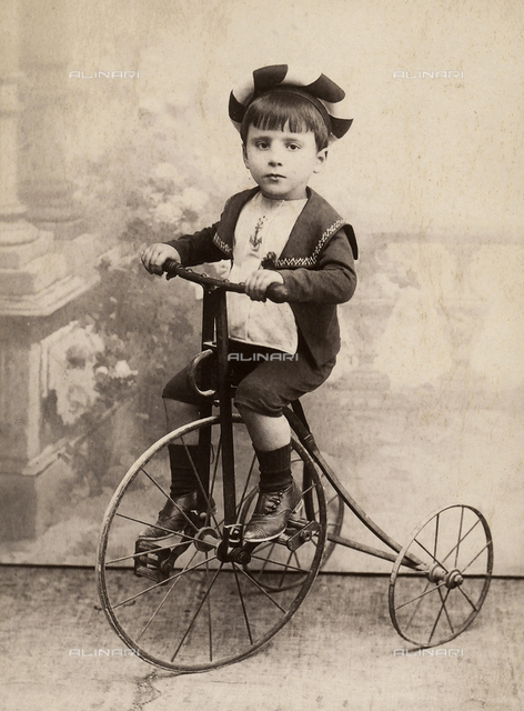 Portrait of a small boy on a tricycle