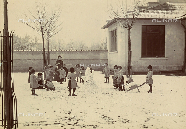 Some children playing on the snow in their school garden in Lyon.