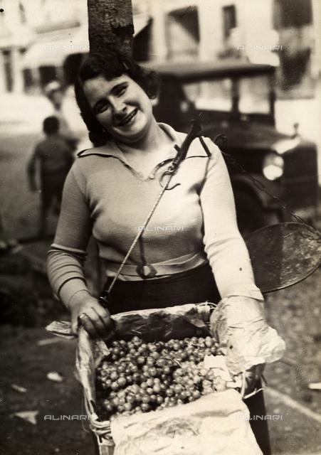 Female grape vendor at the Turin market