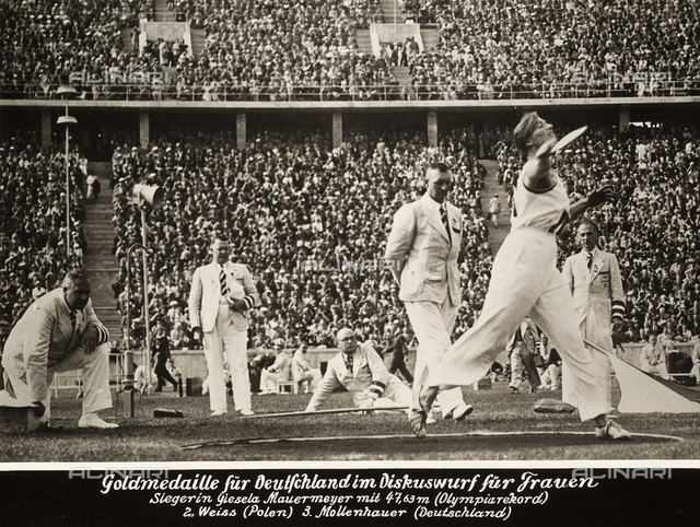The athlete Giesela Mauermeyer throws the discus; throw with which she won the gold medal at the 1936 Berlin Olympic Games