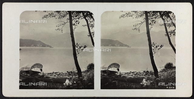 Panorama of Lake Como, with a  boat pulled up on the shore; Stereoscopic photograph
