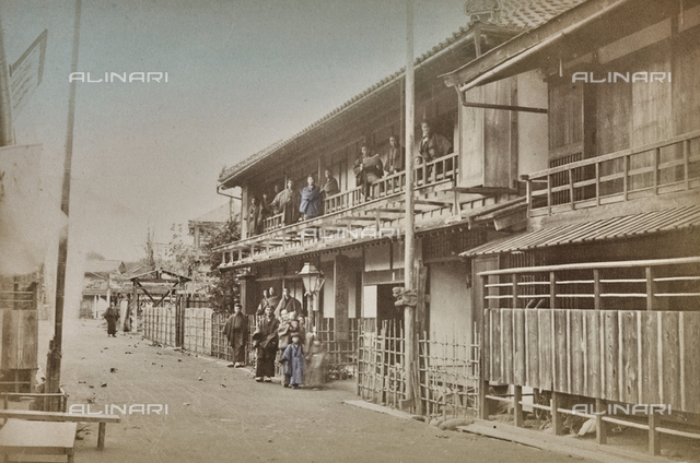 Group of Japanese in traditional clothes photographed in the street