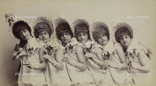 Little girls with hats and umbrellas