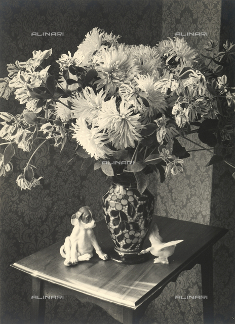 Still life with a vase full of flowers