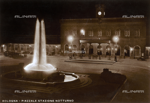 The railway station and the fountain dedicated to the fallen of the Direttissima in 1938, in Piazza Medaglie d'Oro in Bologna, postcard