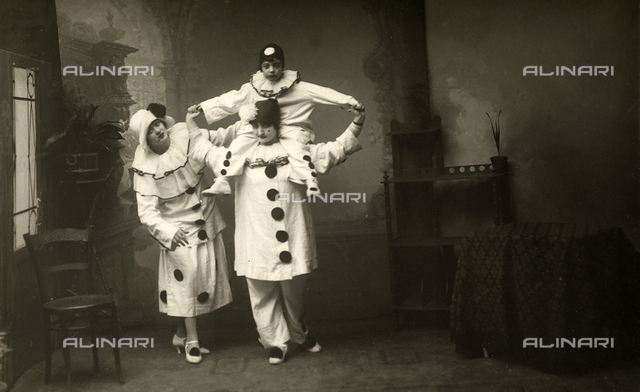 Portrait of group in Pierrot costumes
