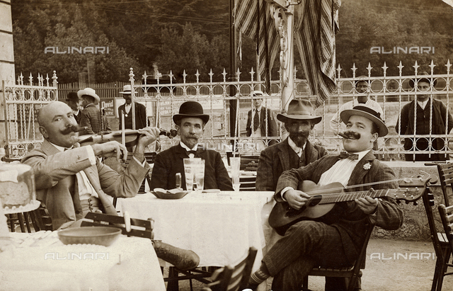 Portrait of musicians seated at a bar, postcard