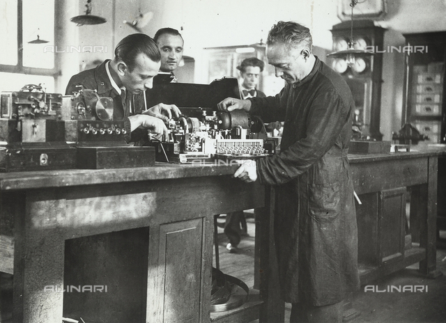 Two technicians repair an instrument in the Central Telegraph Office of Milan