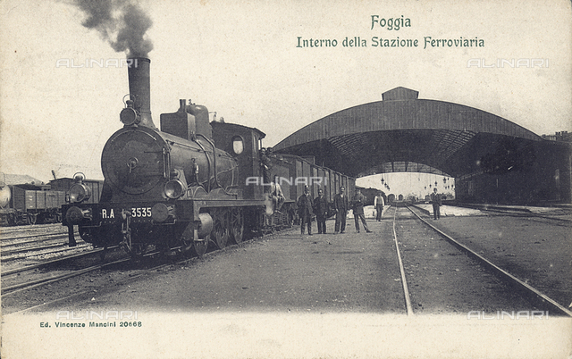 A steam train on the tracks of the train station of Foggia