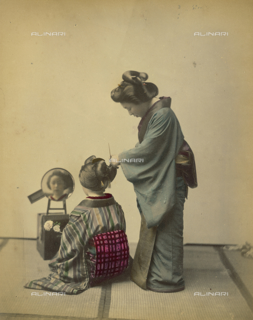 Japanese hairstyle: woman combing a child