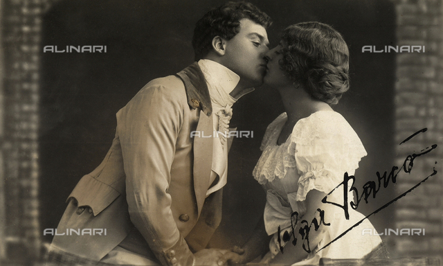 Young couple kissing, dressed in eighteen-hundreds costume