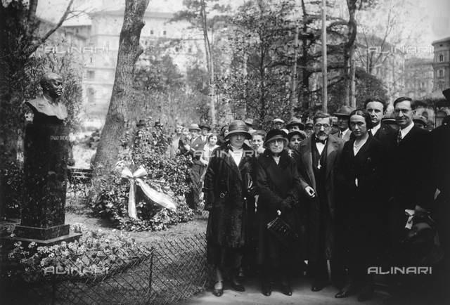 Group of people photographed during the unveiling of the memorial stone to Italo Svevo placed in the Public Park of Triest