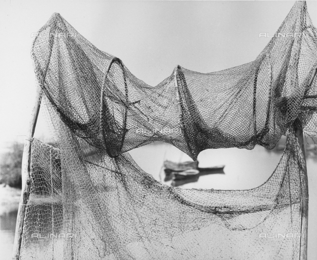 """""""No fishing"""". Fishing nets hung out to dry"""