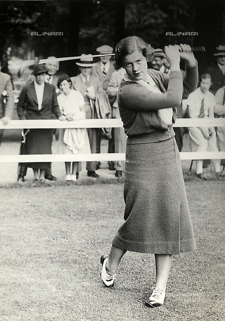 Miss Barton takes a shot during a golf tournament