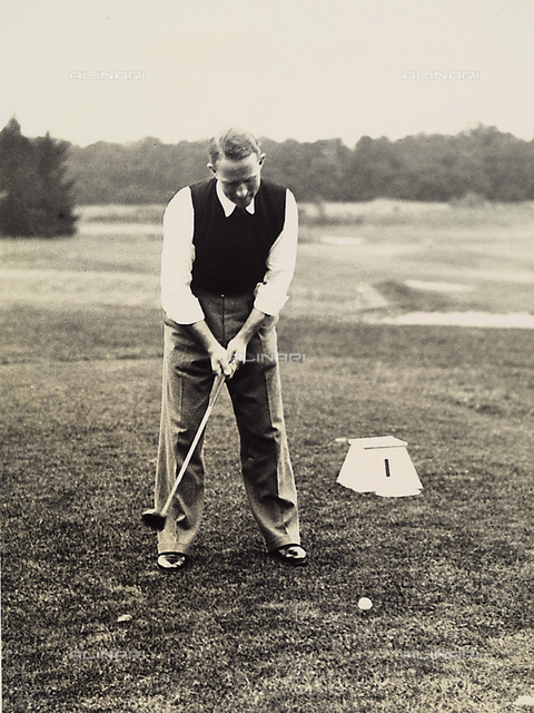 Mr. D'Eichtal takes a shot on a golf course