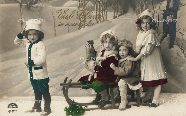 Group of children with a sleigh, Christmas greeting post-card with a 'Viel Glück im neunen Jahre!' inscription on the front side and a personal dedication on the back side, the postage stamp indicates as date of dispatch the 31st December 1911 and Siegmar as city of origin, Germany