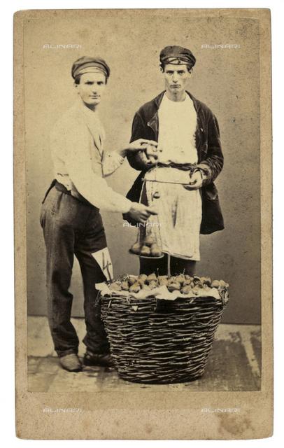 Venetian costumes and masks: fruit vendor