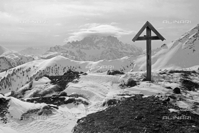 Mountain landscape with snow-covered wooden cross, Cortina d'Ampezzo
