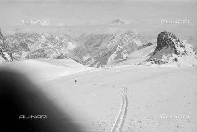 Snowy mountain landscape with man on the snow, Cortina d'Ampezzo