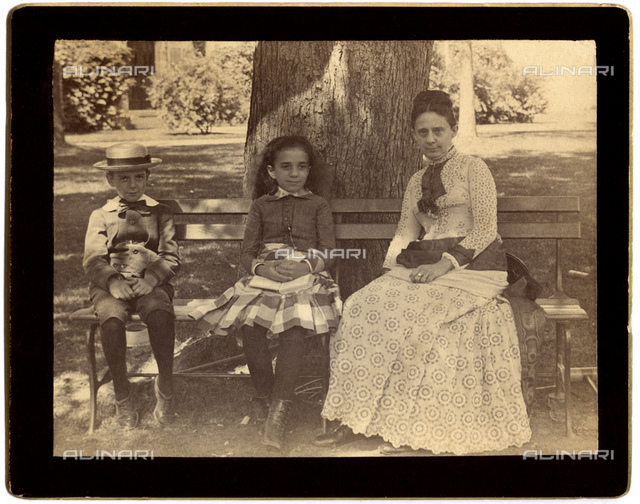 """1886, Summer, TARRYTOWN, NEW YORK, USA : HELEN DAY MILLER (1838 - 1889), daughter of Daniel S. Miller the rich financer, married in 1863 with the Railways magnate and """" Robber Baron """" JASON JAY GOULD (1836 - 1892). The couple have 6 sons. This photo was shot by the young aged 15 son named HOWARD GOULD (1871 - 1959) at family Castle in Tarrytown, N.Y.. In this photo Hellen Miller Gould figure with his daughter, named ANNA GOULD (1875 - 1961) married 2 time with french nobilities: in 1895 the Count Paul Boniface BONI de CASTELLANE (1867 - 1932) and the couple have 5 sons but divorced in 1906, after remarried with the cousin of Boni the Duke Hélie de TALLEYRAND Périgord count et prince de Sagan (1858 - 1937) with others 2 sons. The other boy in this photo is the youngest son named FRANK JAY GOULD (1877 - 1956) later married with two actress and a singer in France."""