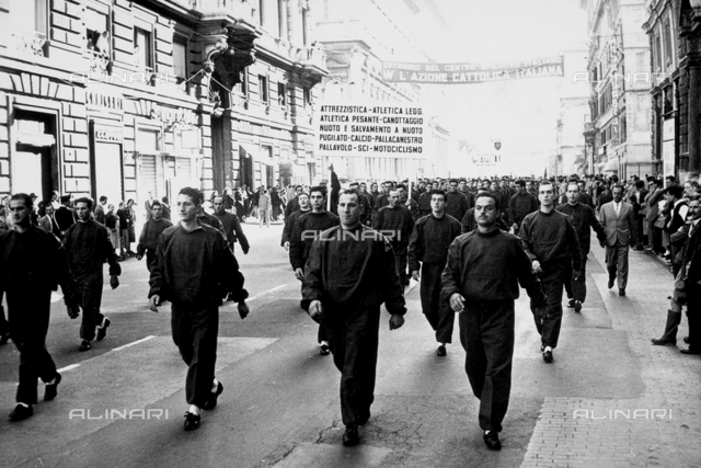 The ceremonies and games called by the Centro Sportivo Italiano: the athletic teams walking down a street in Rome in the procession of athletes