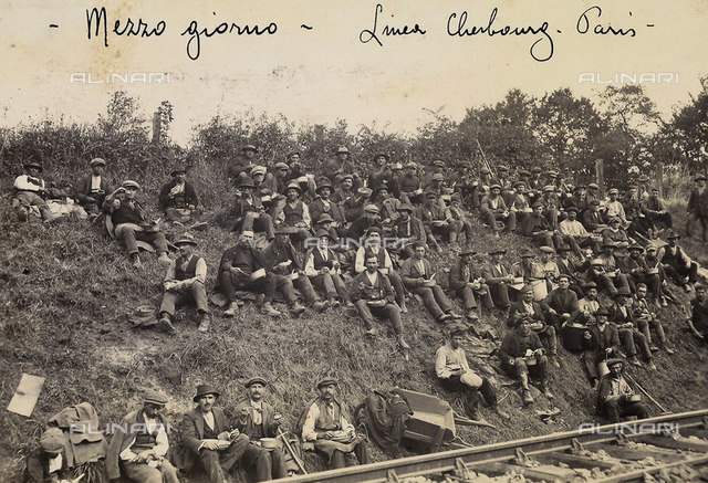 Italian workers eating lunch during the reconstruction work on the Cherbourg-Paris section of the French railway lines