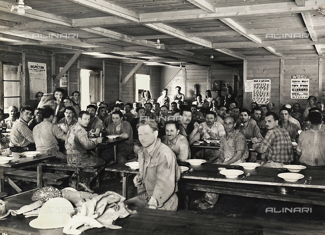 A group of miners at lunch in the dining hall