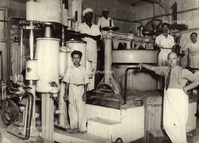 Italians working abroad: a group of workers in a food processing factory in Bahia, Brazil