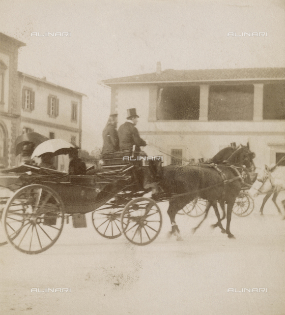 Queen Victoria of England with her daughter Princess Beatrice of Battenberg and a lady-in-waiting to board a carriage while crossing the square of the Cascine in Florence