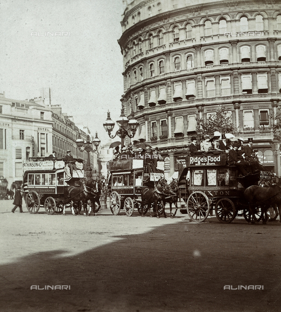 Horse-drawn streetcars, passing in front of the Grand Hotel in Trafalgar Square, in London