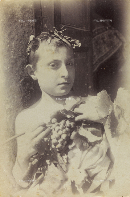 Portrait of a child with bunch of grapes
