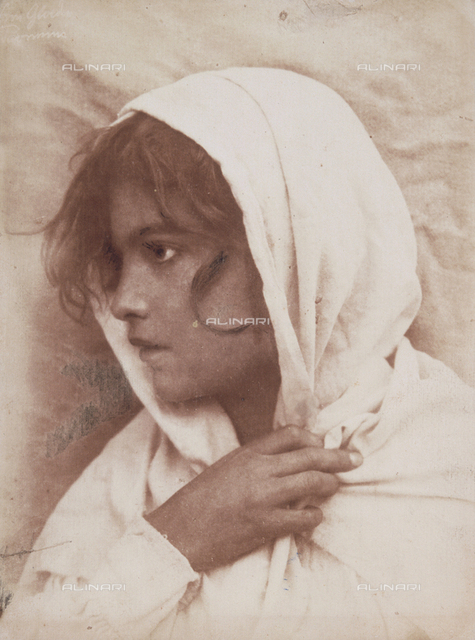 Young girl with a white veil