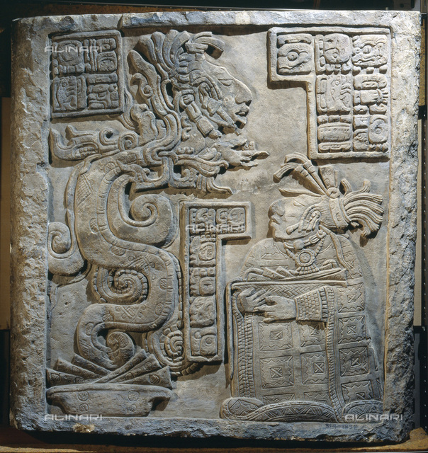Lintel 15 of Yaxchilan Structure 21, Mayan, Mexico, 770. From a series illustrating the accession rituals of the ruler Lord Bird Jaguar. Here one of his wives, after making a blood sacrifice, conjures a vision of an ancestor who emerges from the mouth of a serpent coiled through a beaded blood scroll. From the British Museum, London