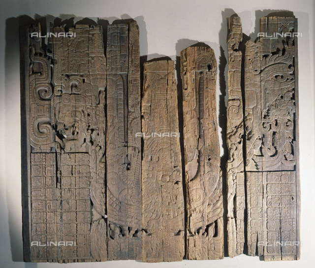 Mayan low-relief carved wood lintel from Temple IV at Tikal, Guatemala, 741. Collected in 1877 by the explorer Gustav Bernoulli, it portrays a Maya lord under an arched double-headed serpent, flanked by glyphs. From the Museum fur Volkerkunde, Basel, Switzerland