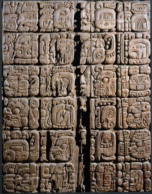 Detail of a Mayan low-relief carved wood lintel from Temple IV at Tikal, Guatemala, c743. Collected in 1877 by the explorer Gustav Bernoulli, the complete lintel portrays Yik'in Chan K'awiil seated under a double-headed serpent, flanked by glyphs and was commissioned to celebrate his victory over El Peru in 743. From the Museum fur Volkerkunde, Basel, Switzerland