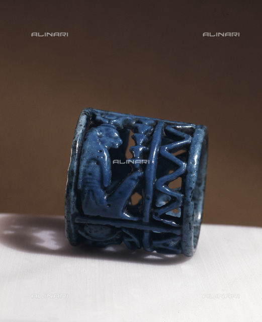 Blue faience amuletic finger ring, Ancient Egyptian, 21st-22nd dynasty, c1075-730 BC. Found at Tuna el-Gebel. A ring with figures of Thoth, Horus and Isis incorporated in the design. From the Schimmel Collection, New York