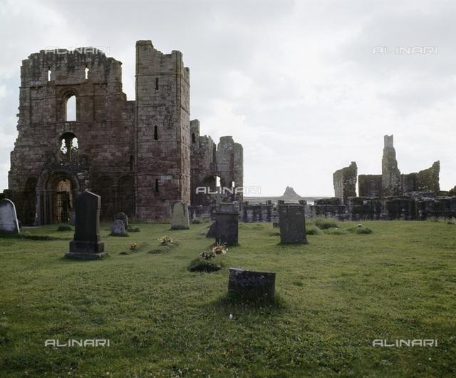 Lindisfarne Priory, Northumberland. The ruins of the priory church date from 1093-1140. A monastery was founded on Lindisfarne (Holy Island) by St Aidan in 634 AD, but it was ransacked in a raid by the Vikings in 793. Nothing of the original monastery remained when a Benedictine Priory was founded on the island by monks from Durham Cathedral after the Norman Conquest