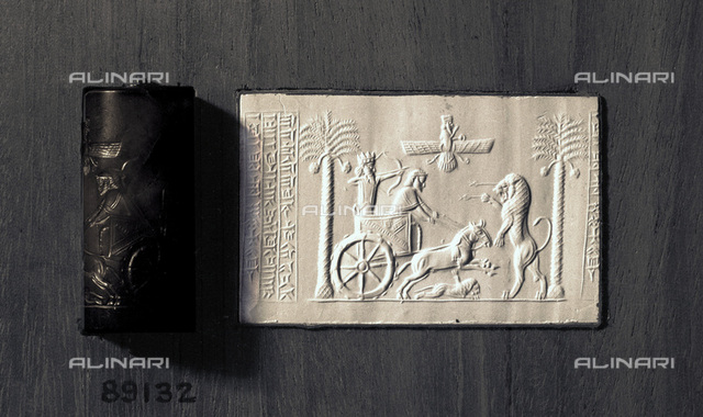 Agate cylinder seal and impression depicting the Persian King Darius, 521-485 BC. Found at Thebes, Egypt. Darius is portrayed in a chariot hunting lions. The winged disk of the god Ahura Mazda is above. The inscription at the side is in the three languages of the Persian Empire, Old Persian, Elamite and Babylonian. From the British Museum, London