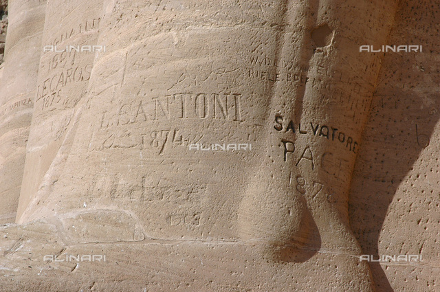 19th century travellers' graffiti, Temple of Rameses II, Abu Simbel, Egypt. The great rock-cut Temple of Abu Simbel was built during the reign of the pharaoh Rameses II (ruled 1279-1212 BC) and dedicated to the gods Amon-Re, Re-Horakhte and Ptah and the Rameses himself. It was built as a lasting monument to Rameses and his wife Queen Nefertari and to commemorate his victory at the battle of Kadesh. It served as a reminder to Egypt's Nubian neighbours of the prowess of the pharaoh. Rameses' reign was notable for a dramatic upsurge in the rate of temple building. The existence of the temple at Abu Simbel was unknown outside Egypt in modern times until 1813. It was explored in 1817 by the Italian explorer and antiquity seeker Giovanni Battista Belzoni (1778-1823)