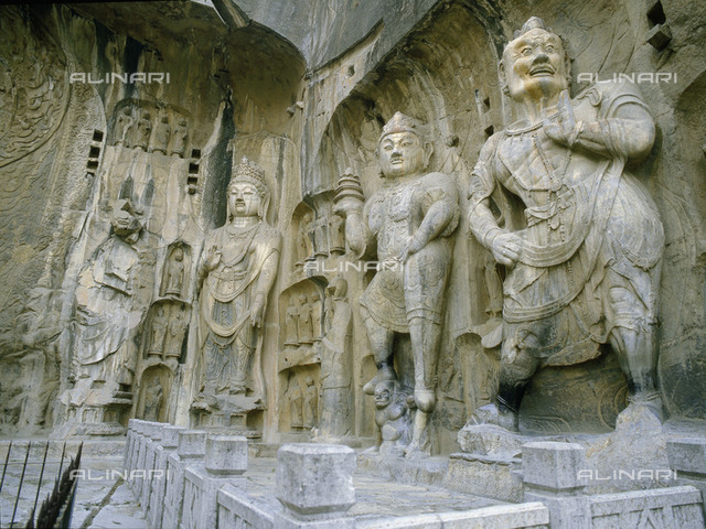 The guardian kings of Buddhism carved on the north wall of the Fengxian temple at the Longmen cave-temple complex. Country of Origin: China. Culture: Buddhist. Date/Period: AD 655-675. Place of Origin: near Luoyang, Henan province.
