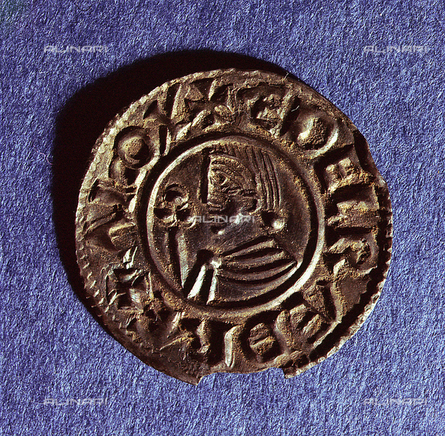 Silver penny of Ethelred II (978-1016) CRVX (Crux) type with sceptre with trefoil head. This was the last among the English coins found in Scandinavian hoards. Country of Origin: England. Culture: Viking. Date/Period: c.991 - c.927. Material Size: Silver. British Museum, London