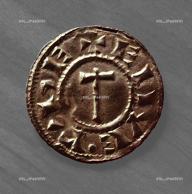 A sword/hammer type coin, Danelaw.Such coins were extorted from the English by the Vikings. Country of Origin: England. Culture: Viking. Date/Period: c. 920. Place of Origin: Danelaw. British Museum, London