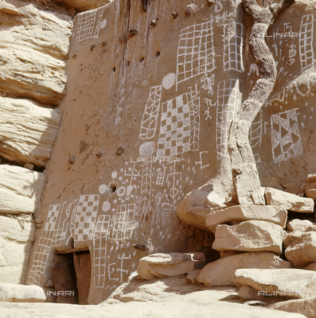 Mud reliefs and elaborate paintings on the wall of a Dogon shrine. The ladder to the roof may also symbolize a transition to heaven. Country of Origin: Mali. Culture: Dogon. Place of Origin: Bandiagara cliffs.