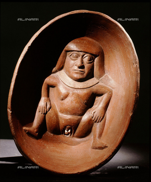 Shallow bowl with relief modelled woman at base with prominent vulva. Country of Origin: Peru. Culture: Mochica. Material Size: Ceramic. Rassiga Collection, New York