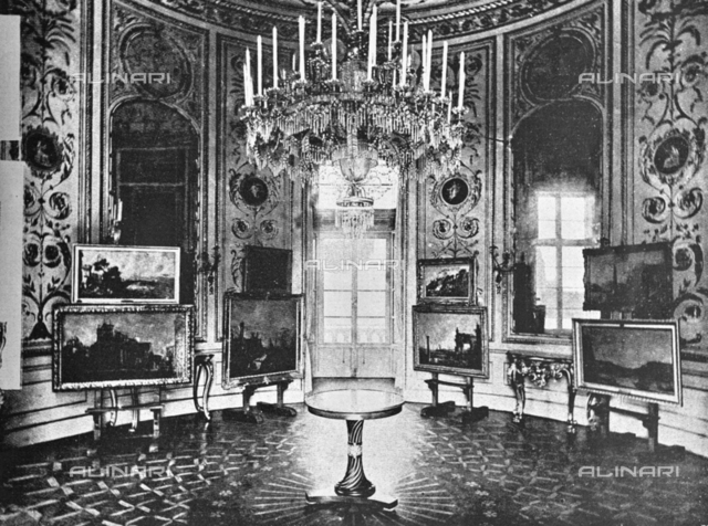 "Cabinet of the Queen of Palazzo Pitti where the paintings of Canaletto and Guardi were exhibited on the occasion of the Italian Painting Exhibition of the 17th and 18th centuries. Photograph taken from the magazine ""L 'Illustrazione italiana"" of 25 June 1922, n. 26, page 761"