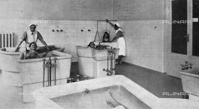 "The Bologna Center Antipoliomyelitis: nurses to patients in bathing tubs shaped, photography taken from the magazine ""L'Illustrazione Italiana"" of 29 november 1942, page 555"