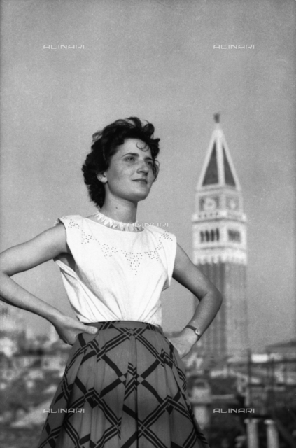 Portrait of a woman with the bell tower of San Marco in the background, Venice