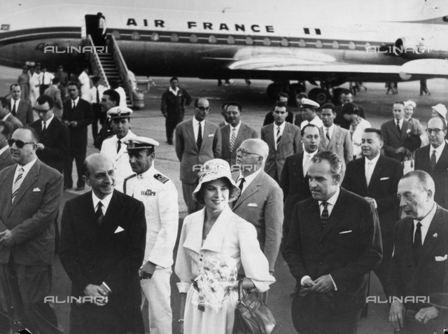 Prince Rainier of Monaca and Grace Kelly at the airport.